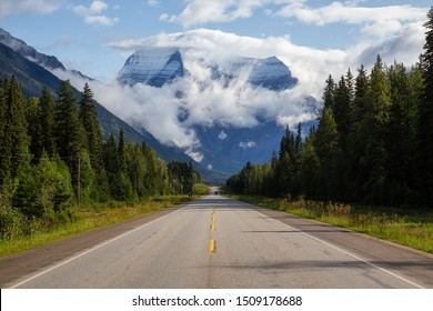 Beautiful View of Yellowhead Highway with Mount Robson in the background during a cloudy summer morning. Taken in British Columbia, Canada.