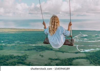 Beautiful view of young woman swing on the top of the mountain Redonda in Dominican Republic. Concept travel, vacation