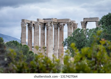 Beautiful view of Zeus temple in Athens with green foreground, Greece