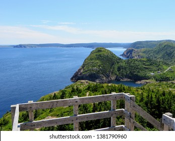 Beautiful views hiking the east coast trail from a lookout  Below is the vast atlantic ocean, rugged headlands, and green forests off the beautiful coast of Newfoundland and Labrador, Canada.