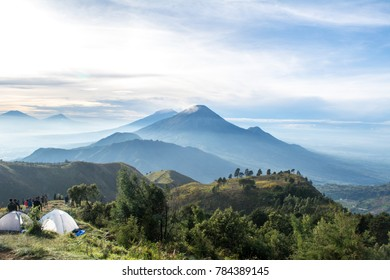Beautiful views of mountain peaks Prau Dieng, Central Java and the climbers