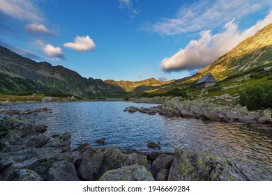Beautiful views of the Polish High Tatras with mountain lakes and picturesque houses in the summer season