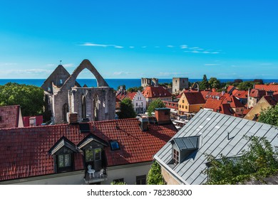 Beautiful views of Visby, main city on Gotland, island in Baltic Sea in Sweden.Best-preserved historical medieval city in Scandinavia. View above. Orange tiled rooftops and blue sky, sea on background