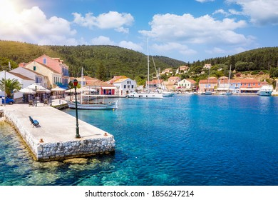 The beautiful village of Fiscardo, Kefalonia island, Greece, with the marina for sailboats and yachts during summer time