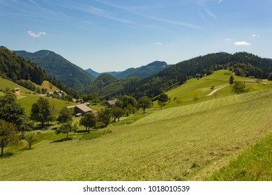 Beautiful village of Sorica, Slovenia: mountains, trees, green meadows. Rural landscape.