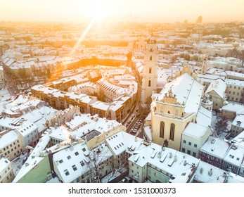 Beautiful Vilnius city panorama in winter with snow covered houses, chruches and streets. Aerial evening view. Winter city scenery in Vilnius, Lithuania.