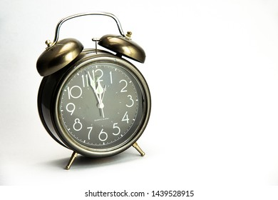 Beautiful vintage alarm clock isolated on white background.