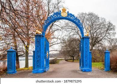 Beautiful vintage blue steel iron gate entrance to the public park Djurgarden in Stockholm Sweden.