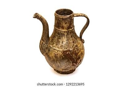 Beautiful vintage cast iron jug on white isolated background