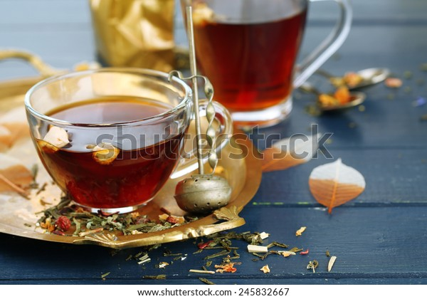 Beautiful vintage composition with herbal tea, on wooden table