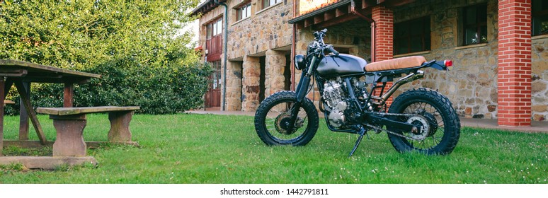 Beautiful vintage custom motorcycle parked on the grass