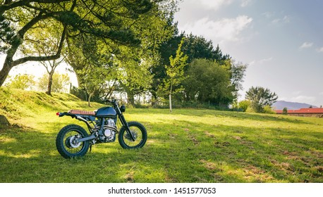 Beautiful vintage custom motorcycle parked on the field
