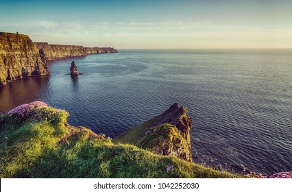 beautiful vintage filter scenic irish countryside landscape from the cliffs of moher in county clare , ireland