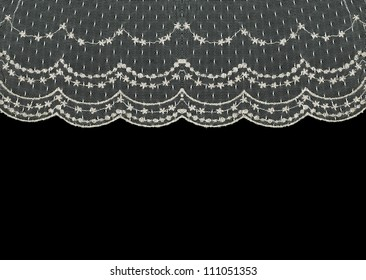Beautiful vintage floral lace curtain isolated on black background with room for your text