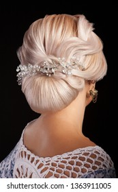beautiful vintage hairstyle of blonde woman isolated on black background. High fashion coiffure.