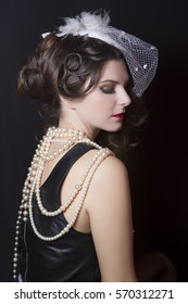 Beautiful vintage hairstyle with a white hat. Studio photography