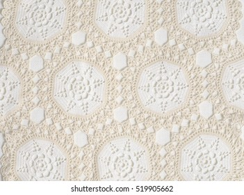 Beautiful vintage handmade crochet with snowflake pattern on white texture