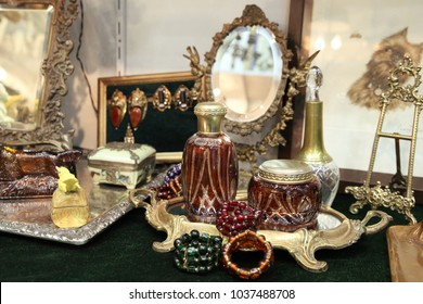Beautiful vintage items, mirrors and jewelry at the flea market goods.