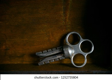 Beautiful vintage key on the old wooden background. Empty place, free place.