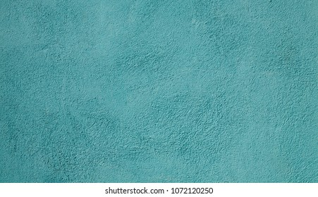 Beautiful Vintage light turquoise Background. Abstract Grunge Decorative Stucco Wall Texture. Wide Rough Background With Copy Space For Text