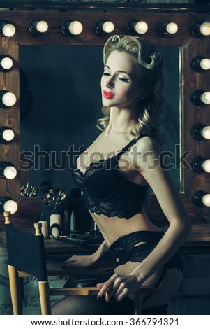 b477836c9 Beautiful vintage style pinup young woman in sexy lingerie. Glamour  hairstyle. Sensual body posing