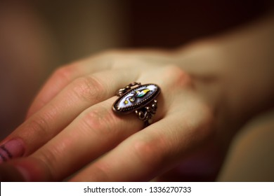 beautiful vintage stylish antique ring on the middle finger of a young girl