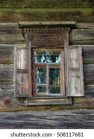 beautiful vintage traditional Russian log house with wooden windows