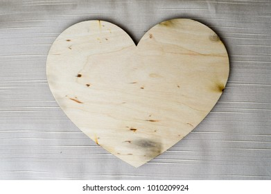 A beautiful, vintage, wooden heart on Valentine's Day on a beige background.