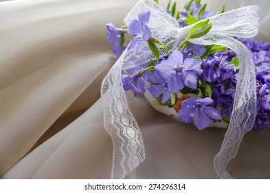 beautiful Viola flowers with lace bow