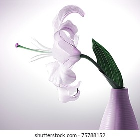 Beautiful violet lily flower in the vase with back light, studio isolated