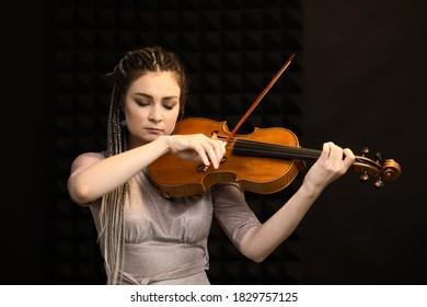 Beautiful violist girl playing the viola