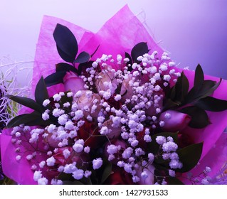 beautiful vivid bouquet of roses,ghipsofila and ruscus.Vivid floral arrangement.