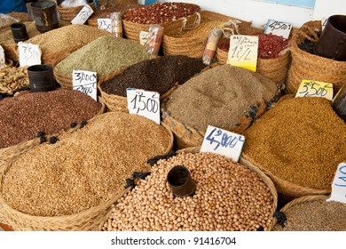 Beautiful vivid oriental market with baskets full of various spices