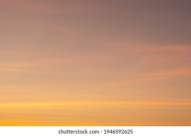 Beautiful Vivid sky painted by the sun leaving bright golden shades.Dense clouds in twilight sky in winter evening.Image of cloud sky on evening time.Evening Vivid sky with clouds. - Shutterstock ID 1946592625