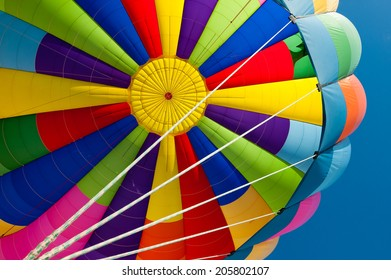 Beautiful vivid and vibrant colors of a hot air balloon. Exciting flying experience in the blue sky.