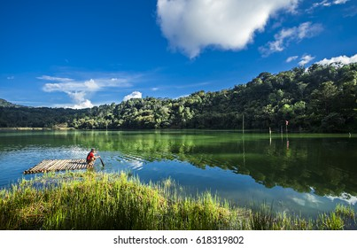 Beautiful volcanic lake of Linow Lake in North Sulawesi, Indonesia with fisherman