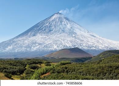 Beautiful volcanic landscape: Klyuchevskaya Sopka Volcano - active volcano of Kamchatka Peninsula. Russia.. The volcano of Klyuchevskaya Hill (4800 m) is the highest active volcano of Eurasia.