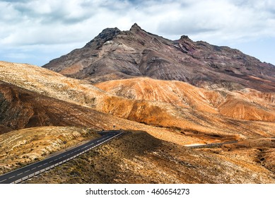 The beautiful volcanic landscape with road on the island of Fuerteventura. Canary Islands. Spain