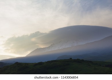Beautiful volcanic landscape, slopes of mountains in the rays of the setting sun, Kamchatka Peninsula