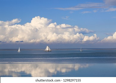 The Beautiful Waddenzee (Wadden Sea)  in Holland - Romantic View of the Blue Sky, White Clouds and Sailing Boats on a Sunny Day. Taken from the Afsluitdijk