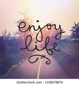 Beautiful walking path with Quote - Enjoy Life