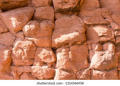 Beautiful wall of sandstone mountains, red rock canyon sandstone background. Beautiful sandstone texture.