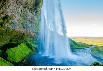 Beautiful wallpaper of magical waterfall. Iceland waterfall Skogafoss in Icelandic nature landscape. Famous tourist attractions and landmarks destination in Icelandic nature landscape on South Iceland