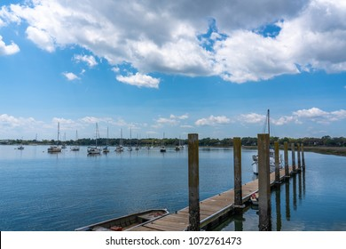 a beautiful warm day at the Beaufort SC waterfront showing the pier and a blue sky with white puffy clouds