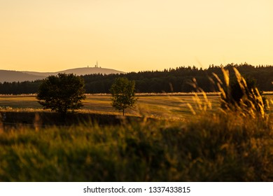 Beautiful warm summer sunset in harz mountains with view on mountain brocken