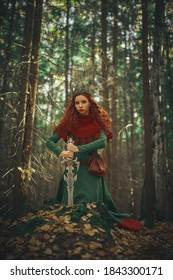 A beautiful warrior woman with a sword in a deep forest. Ancient legends. Fantasy world.