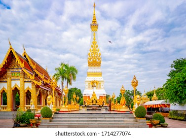 Beautiful Wat Phra That Phanom is a temple in That Phanom District in the southern part of Nakhon Phanom Province, northeastern Thailand, famous temple landmark, lens flare rainbow beautiful photo