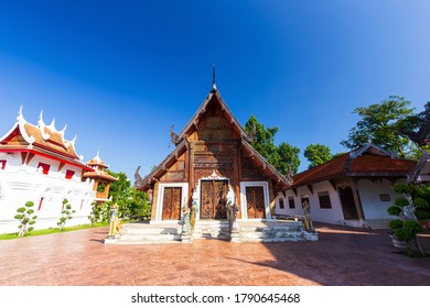 Beautiful of Wat Pratu Pong temple at Lampang with blue sky in sunny day, An ancient temple decorated with ancient Lanna art named Lampang Province, Thailand.