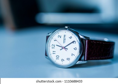 Beautiful Watch with Brown Leather Strap on White Desk