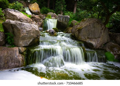 Beautiful water fall in the Japanese Gardens in Holland Park, London in the summer.